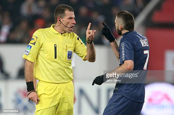Referee Wilfried Bien argues with Jeremy Menez of PSG during the french Ligue 1 match between Paris SaintGermain FC and Montpellier Herault SC at the...