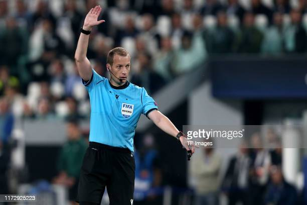 Referee William Collum gestures during the UEFA Champions League group D match between Juventus and Bayer Leverkusen at Juventus Arena on October 1,...