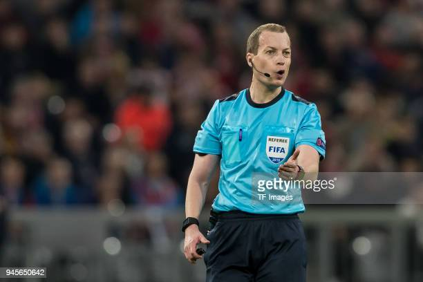 Referee William Collum gestures during the UEFA Champions League quarter final second leg match between Bayern Muenchen and Sevilla FC at Allianz...