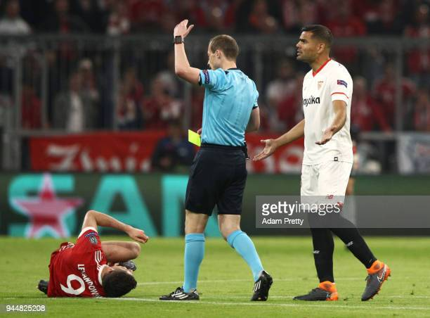 Referee William Collum gets ready to give a yellow card after Robert Lewandowski of Bayern Muenchen is fouled during the UEFA Champions League...