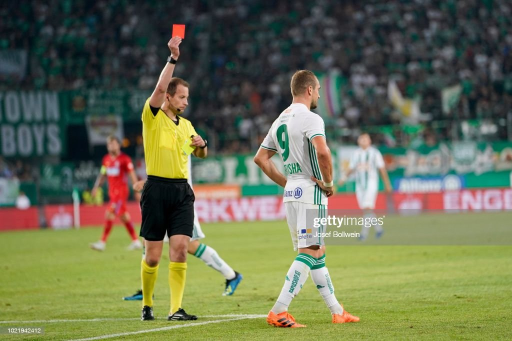 Referee William Collum issues Veton Berisha of Rapid a red ...