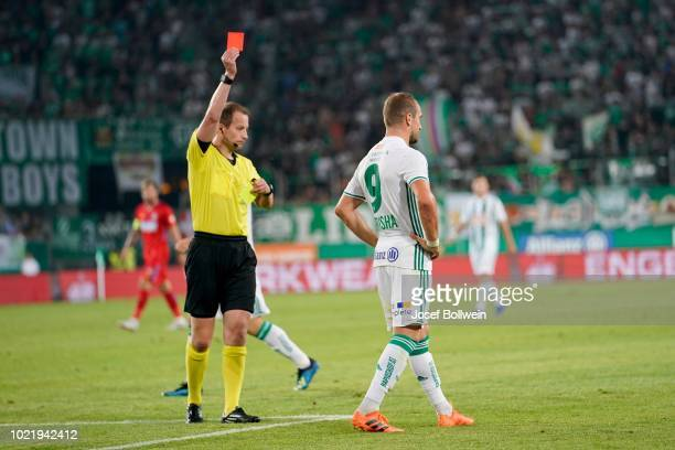 Referee William Collum issues Veton Berisha of Rapid a red card during the UEFA Europa League Play Off: First Leg match between Rapid v FCSB Bukarest...