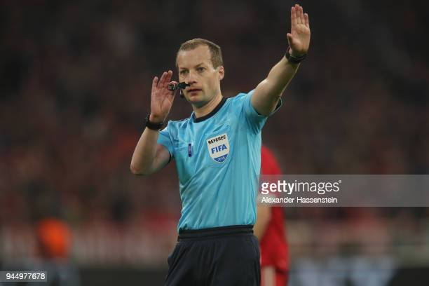 Referee William Collum reacts during the UEFA Champions League Quarter Final Second Leg match between Bayern Muenchen and Sevilla FC at Allianz Arena...
