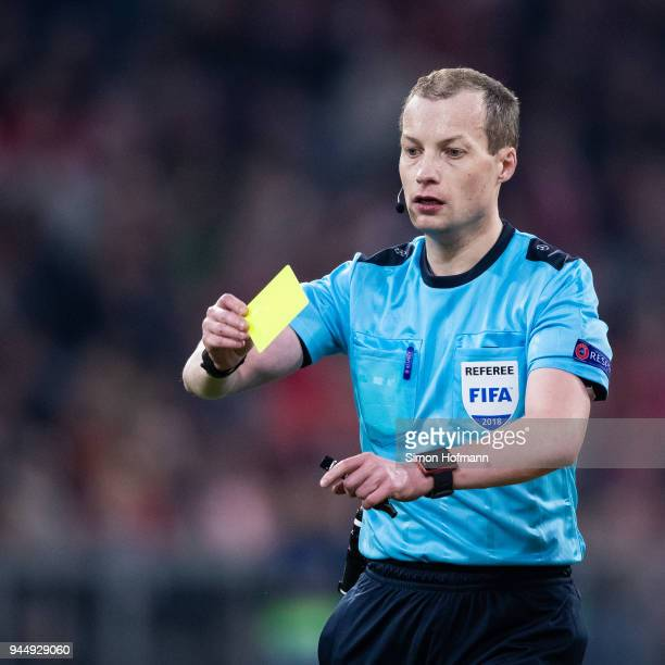 Referee William Collum shows the yellow card during the UEFA Champions League Quarter Final second leg match between Bayern Muenchen and Sevilla FC...