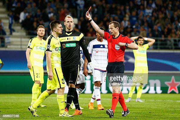 Referee, William Collum shows Thomas Foket of Gent a red card during the UEFA Champions League Group H match between KAA Gent and Olympique Lyonnais...