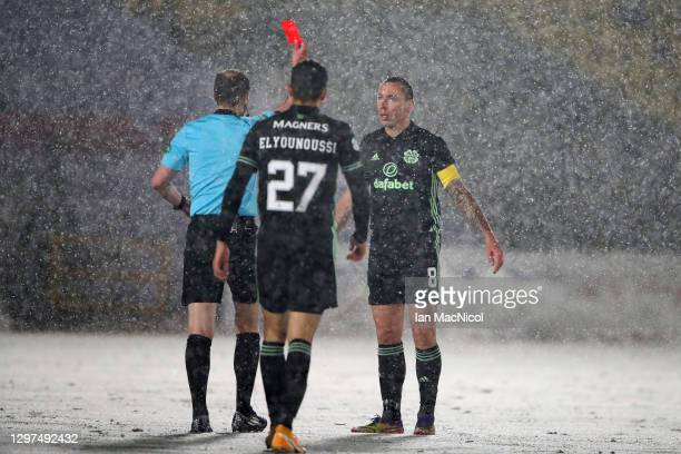 Referee, Willie Collum shows Scott Brown of Celtic a red card during the Ladbrokes Scottish Premiership match between Livingston and Celtic at Tony...