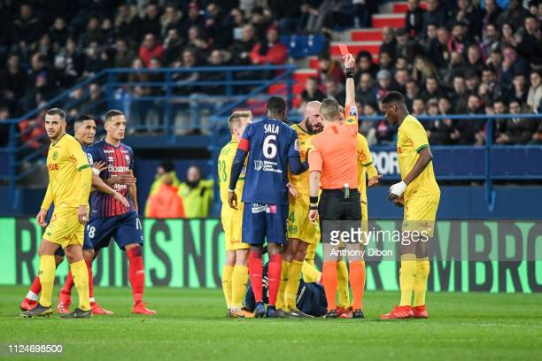 Referee Willy Delajod gives a red card to Andrei Girotto of Nantes during the Ligue 1 match between Caen and Nantes at Stade Michel D'Ornano on...