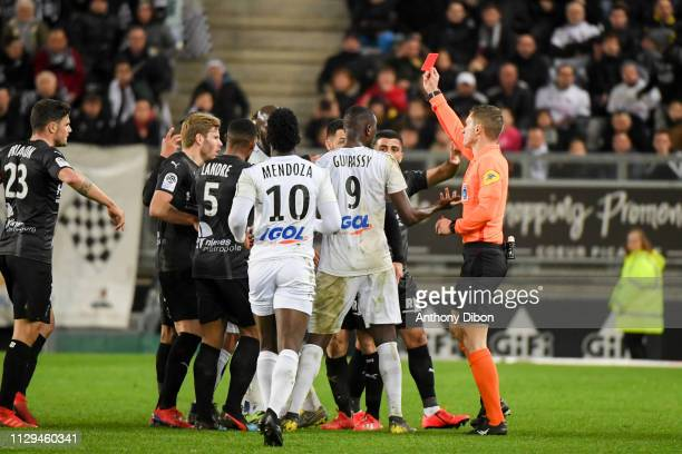 Referee Willy Delajod gives a red card to Sehrou Guirassy of Amiens during the Ligue 1 match between Amiens and Nimes at Stade de la Licorne on March...