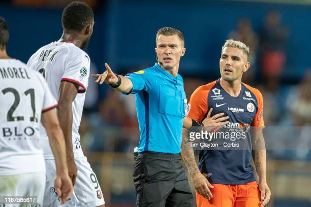 Referee Willy Delajod separates Jordan Siebatcheu of Rennes and Andy Delort of Montpellier during the Montpellier Vs Stade Rennes French Ligue 1...