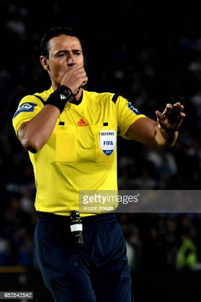 Referee Wilmar Roldan gestures during a match between Millonarios and America de Cali as part of the round 9 of Liga Aguila I at Nemesio Camacho El...