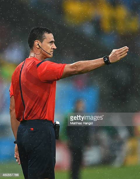 Referee Wilmar Roldan signals a call in the first half during the 2014 FIFA World Cup Brazil Group A match between Mexico and Cameroon at Estadio das...