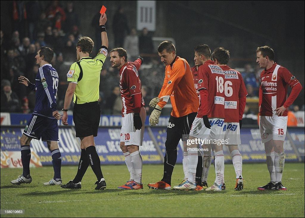 MONS, BELGIUM - DECEMBER 08 Referee Wim Smet gives a red card to Cedric Berthelin (RAEC Mons) during the Jupiler League match between RAEC MONS vs RSC Anderlecht on December 08 , 2012 in Mons, Belgium.
