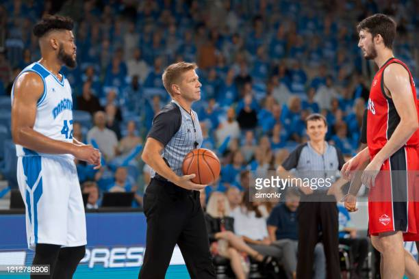 referee with basketball in court - referee stock pictures, royalty-free photos & images