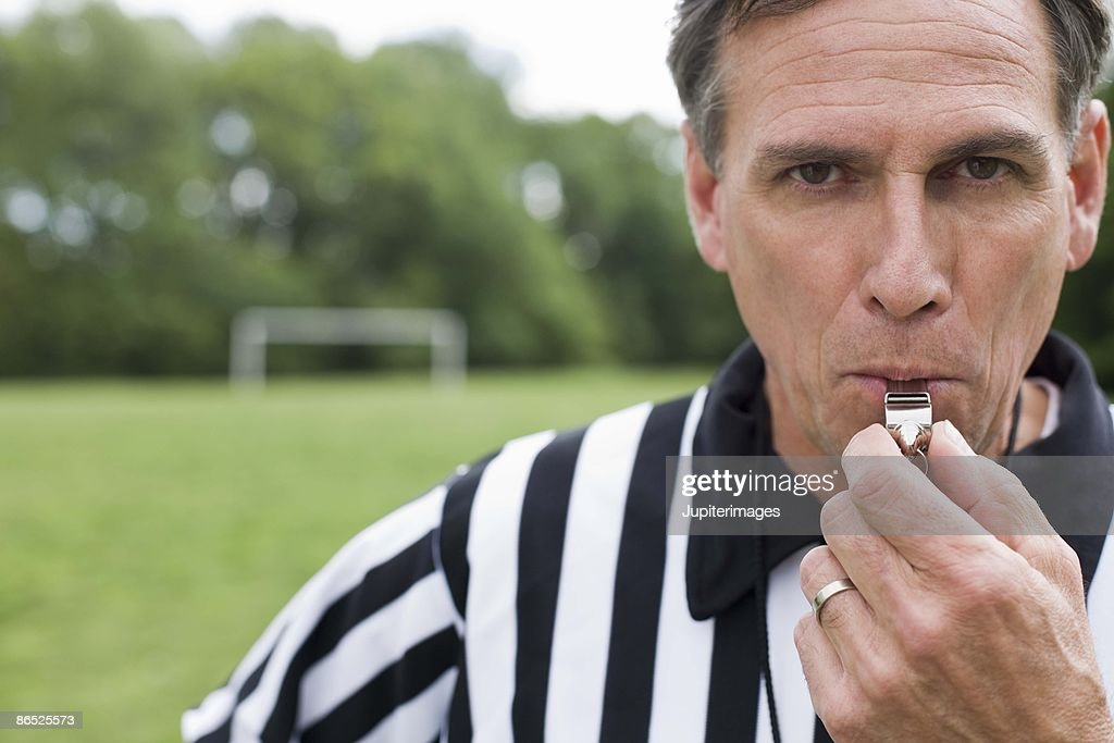 Referee with whistle : Stock Photo
