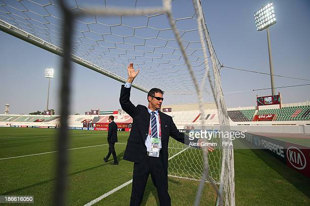 Referee Wolfgang Stark checks the net of the goal prior to the FIFA U17 World Cup UAE 2013 Quarter Final match between Argentina and Ivory Coast at...
