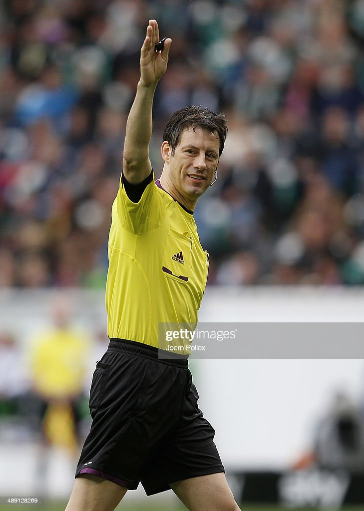 Referee Wolfgang Stark gestures during the Bundesliga match between at Volkswagen Arena on May 10, 2014 in Wolfsburg, Germany.