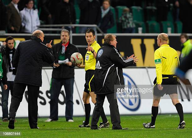 Referee Wolfgang Stark gestures to Steve McClaren head coach and Dieter Hoeness manager of Wolfsburg at the end of the Bundesliga match between VfL...
