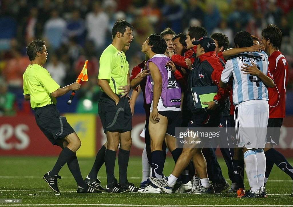 Referee Wolfgang Stark is confronted by the Chilean team after the final whistle of their game against Argentina during their semi-final game at the Fifa U-20 World Cup Canada 2007 at the National Soccer Stadium July 19, 2007 in Toronto, Canada. Several Chilean players charged Stark after the game, during which he had shown Chile seven yellow cards and two red cards.