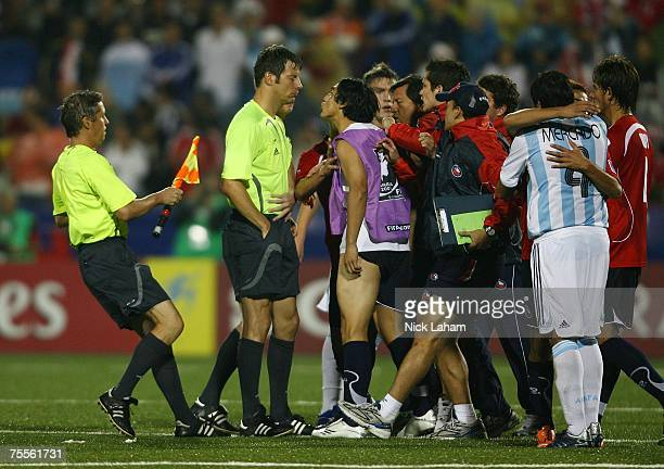 Referee Wolfgang Stark is confronted by the Chilean team after the final whistle of their game against Argentina during their semifinal game at the...