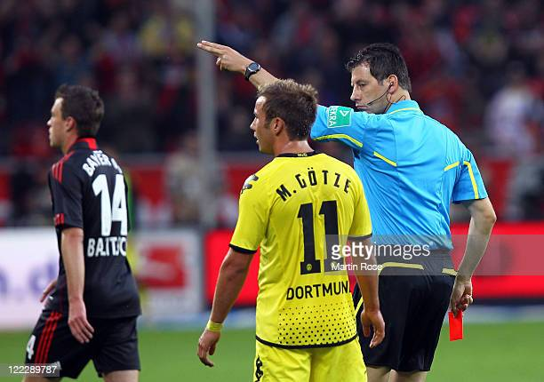 Referee Wolfgang Stark shows Mario Goetze of Dortmund the red card during the Bundesliga match between Bayer Leverkusen and Borussia Dortmund at...