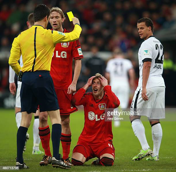 Referee Wolfgang Stark shows Stefan Kiessling of Leverkusen the yellow card for diving during the Bundesliga match between Bayer 04 Leverkusen and...
