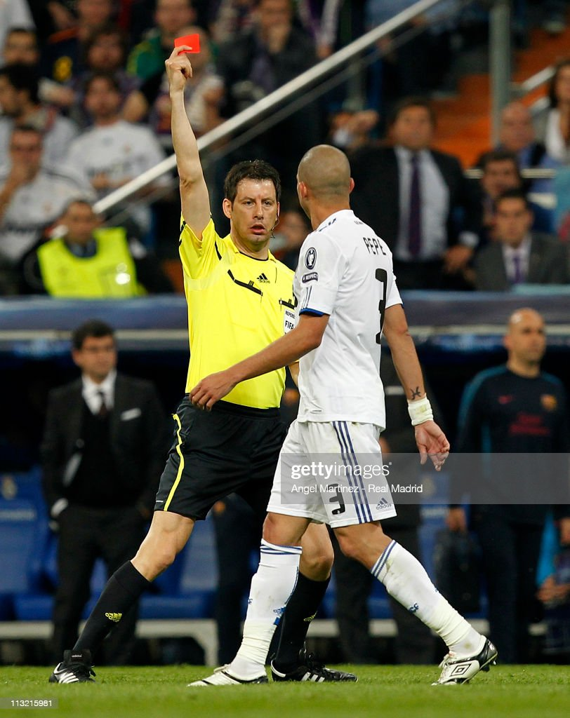 Referee Wolfgang Stark shows the red card to Pepe of Real Madrid during the UEFA Champions League Semi Final first leg match between Real Madrid and Barcelona at Estadio Santiago Bernabeu on April 27, 2011 in Madrid, Spain.