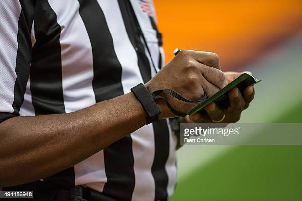 Referee writes notes during a stoppage in play of the game between the Syracuse Orange and the Pittsburgh Panthers on October 24, 2015 at The Carrier...