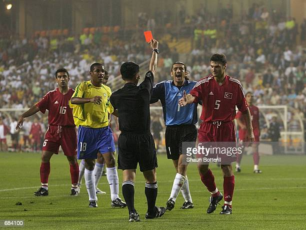 Referee Young Joo Kim of South Korea shows the red card to Alpay Ozalan of Turkey during the second half during the Brazil v Turkey, Group C, World...