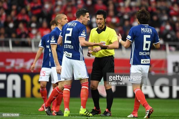 Referee Yudai Yamamoto shows an yellow card to Milos Degenek of Yokohama FMarinos during the JLeague J1 match between Urawa Red Diamonds and Yokohama...