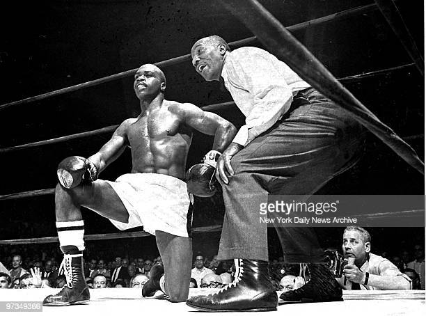 Referee Zach Clayton counts to nine over Rubin Carter after his third knockdown during bout with DickTiger at Madison Square Garden