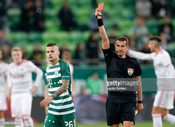 Referee Zoltan Ivanyi shows the red card for Marcel Heister of Ferencvarosi TC during the Hungarian OTP Bank Liga match between Ferencvarosi TC and...