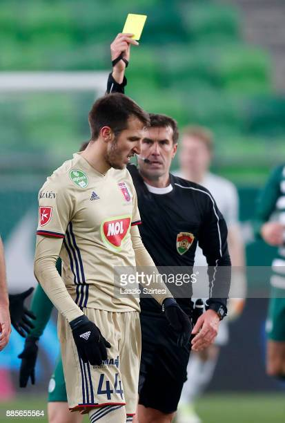 Referee Zoltan Ivanyi shows the yellow card for Marko Scepovic of Videoton FC during the Hungarian OTP Bank Liga match between Ferencvarosi TC and...