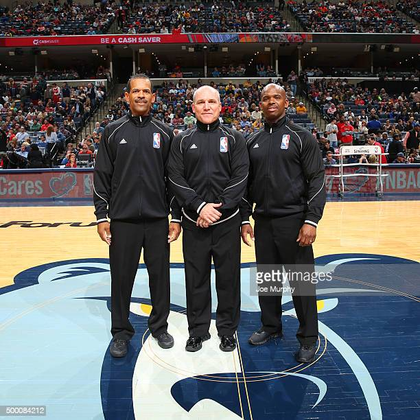Referees #10 Ron Garretson #42 Eric Lewis #21 Dedric Taylor pose for a photo before the San Antonio Spurs play against the Memphis Grizzlies on...