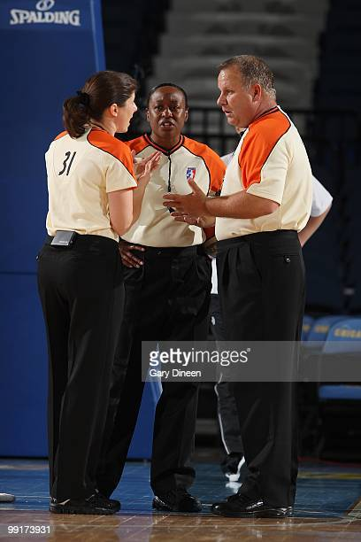 Referees Amy Bonner, Felicia Grinter and Tom Mauer huddle on the court during the WNBA preseason game between the Indiana Fever and the Chicago Sky...