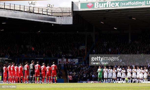 Referees and players from Leeds United FC and Charlton Athletic FC stand and applaud the servicemen and women in the armed forces prior to kick off...