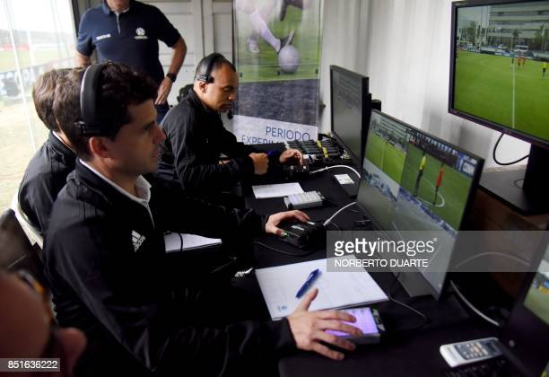 FIFA referees Andres Cunha from Uruguay and Wilson Sampaio of Brazil attend a video assistant referee training course for referees of the region at...