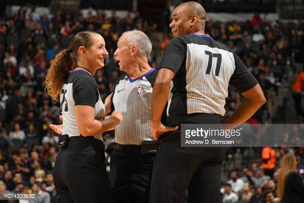 Referees Ashley MoyerGleich Jason Phillips and Karl Lane talk during the game between the Los Angeles Lakers and the San Antonio Spurs on December 7...