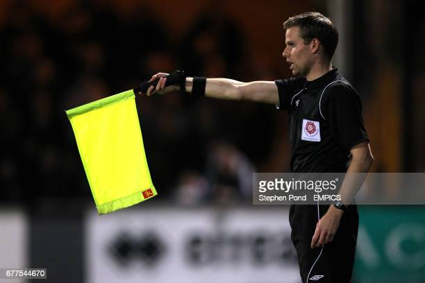 Referee's assistant Constantine Hatzidakis flags for an offside decision
