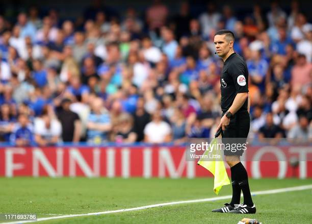 Referees assistant Nick Hopton looks on during the Premier League match between Chelsea FC and Sheffield United at Stamford Bridge on August 31 2019...
