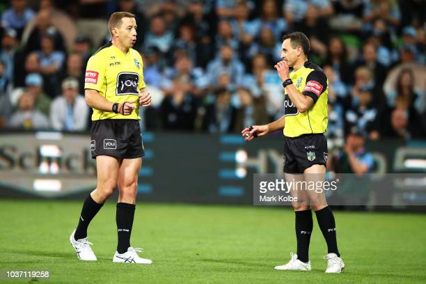 Referees Ben Cummins and Gerard Sutton speak during the NRL Preliminary Final match between the Melbourne Storm and the Cronulla Sharks at AAMI Park...
