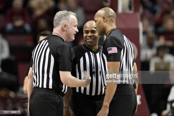 Referees Bert Smith, John Gaffney, and Jeffrey Anderson laugh during a time out in the game between the Syracuse University Orangemen and the Florida...