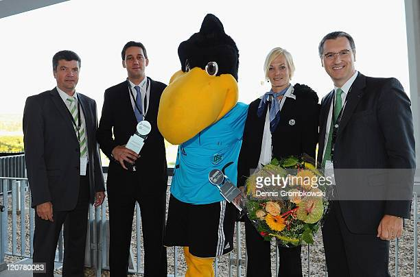 Referees Bibiana Steinhaus and Manuel Graefe receive the 'Referee of the Year 2011' award from Herbert Fandel CEO of the German Referee Comission and...