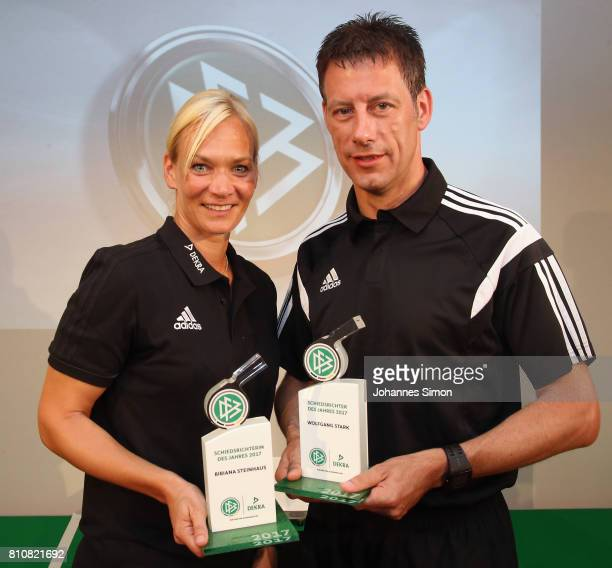 Referees Bibiana Steinhaus and Wolfgang Stark pose with the award trophy after been awarded as referee of the year 2017 on July 8 2017 in Grassau...