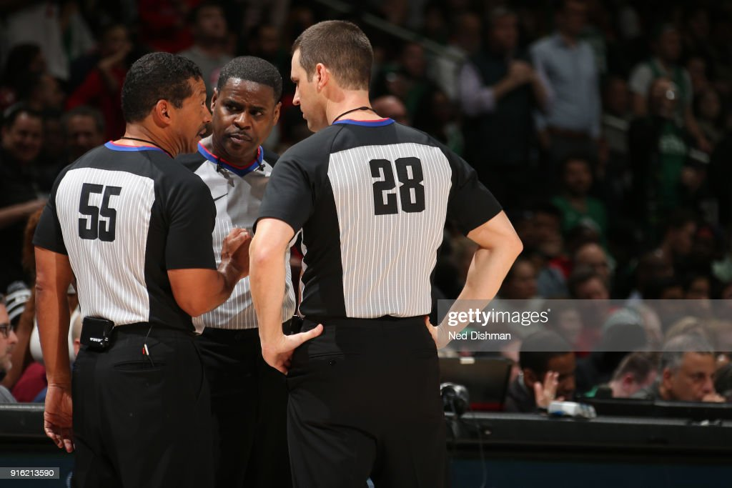 Bill Kennedy, Leroy Richardson and Kevin Scott huddle up during the Boston Celtics game against the Washington Wizards on February 8, 2018 at Capital One Arena in Washington, DC.