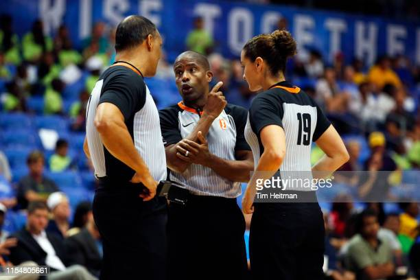 Referees Billy Smith, Eric Brewton and Tiara Cruse talk during a game between the Los Angeles Sparks and the Dallas Wings on July 9, 2019 at the...