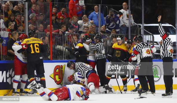 Referees braek up a fight between the players of Germany and of Russia during the 2017 IIHF Ice Hockey World Championship game between Germany and...