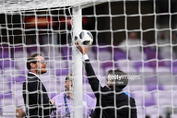 Referees check the video assistant referee system prior to the FIFA Club World Cup UAE 2017 Match for 5th Place between Wydad Casablanca and Urawa...