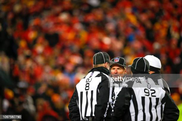 NFL referees confer in a field meeting discussing a penalty call in the AFC Championship Game between the Kansas City Chiefs and the New England...