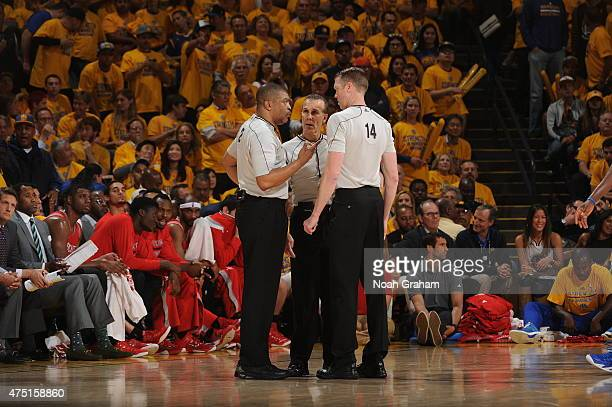 Referees discuss a call during a game between the Houston Rockets and Golden State Warriors in Game Five of the Western Conference Finals of the 2015...