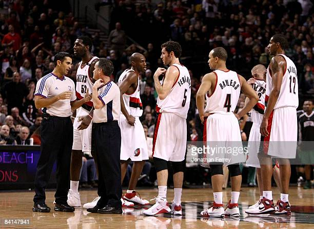 Referees discuss a disputed basket in the first half when the Portland Trail Blazers scored with six players on the court against the Boston Celtics...